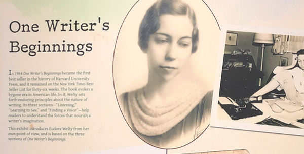The One Writer's Beginnings exhibit panel at the Eudora Welty House & Garden Education and Visitors Center shows a portrait of young Welty and a photograph of the author at work.