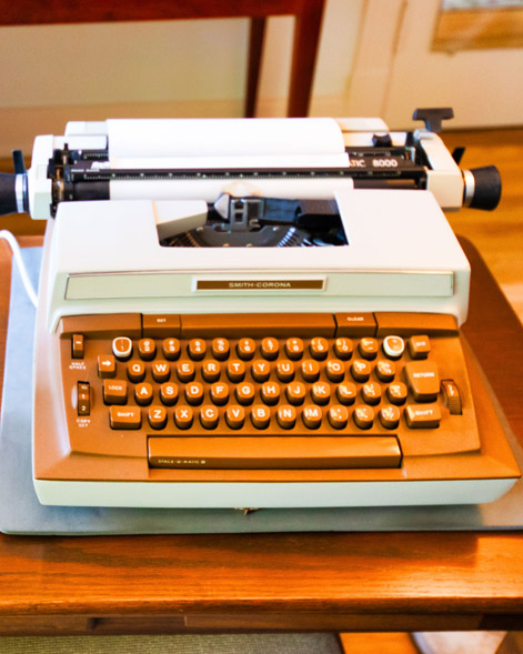 Front of Eudora Welty's Smith-Corona electric typewriter on the wooden desk in her bedroom at the Eudora Welty House & Garden.