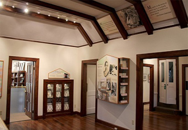 Exhibits on Welty's life are displayed from floor to ceiling inside the Education and Visitors Center museum at the Eudora Welty House & Garden.